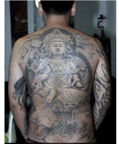 ...一个钟馗捉鬼的纹身满背要多少钱