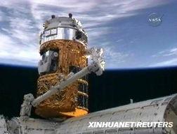 ...片:2009年9月17日,日本无人驾驶太空货运飞船——空间站转运飞...