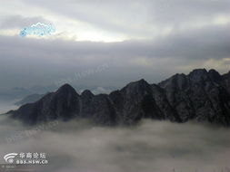 恍旷-蓝天下,群峰叠翠,众岭相交,连绵不绝,峰峦中,白云漂绕,雾气滋...
