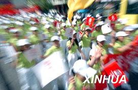 激情五月迎奥运 关注民生促和谐