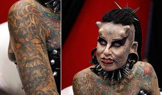 她首先把自己的身体变成了一件艺术品:全身几乎100%的皮肤都有纹...