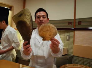矩,比如在撩起寿司店门口麻质暖帘时,手掌应该放置在离底部8厘米...