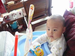 3.喜羊羊小风车.每次有风的时候我都拿起来给宝宝玩.风车一动,宝...